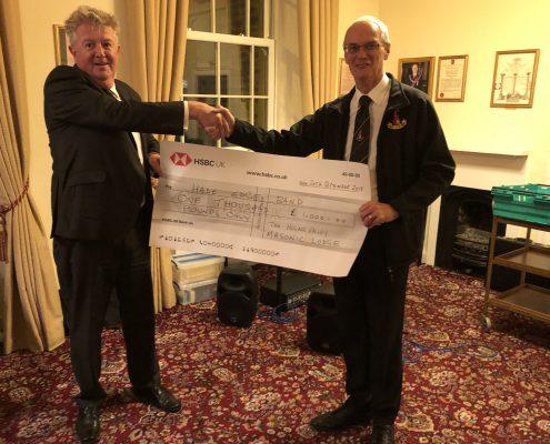 Cheque presentation by WM Ashley Craven to Bandmaster Robert Turnball